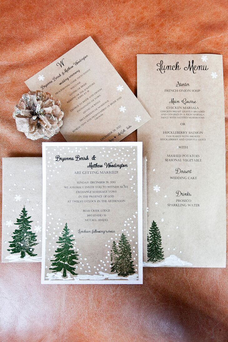 Bryanna and Matthew made the rustic winter wedding invitations themselves with stamped alpine trees and snow decoration.