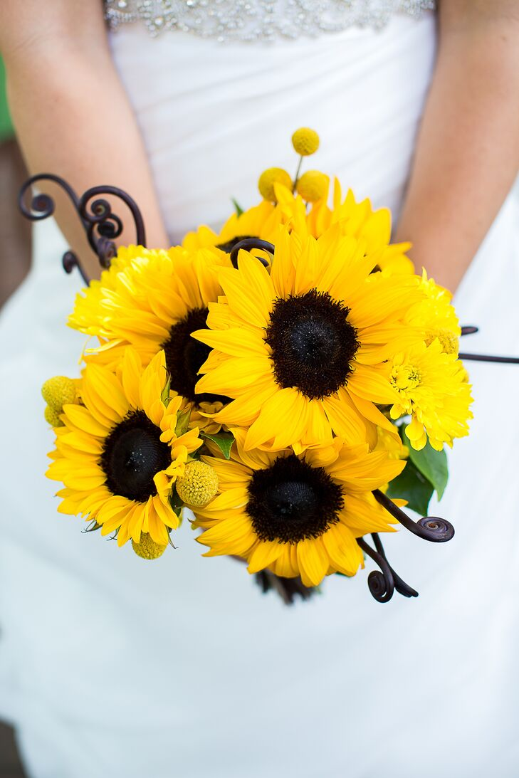 Caitlin carried a bouquet with sunflowers, fiddlehead ferns, craspedia and yellow chrysanthemums.