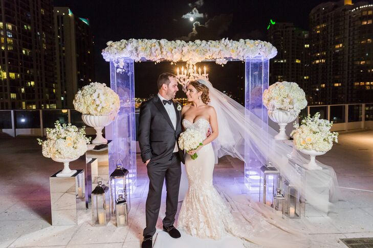 Elegant Couple with Modern Wedding Arch