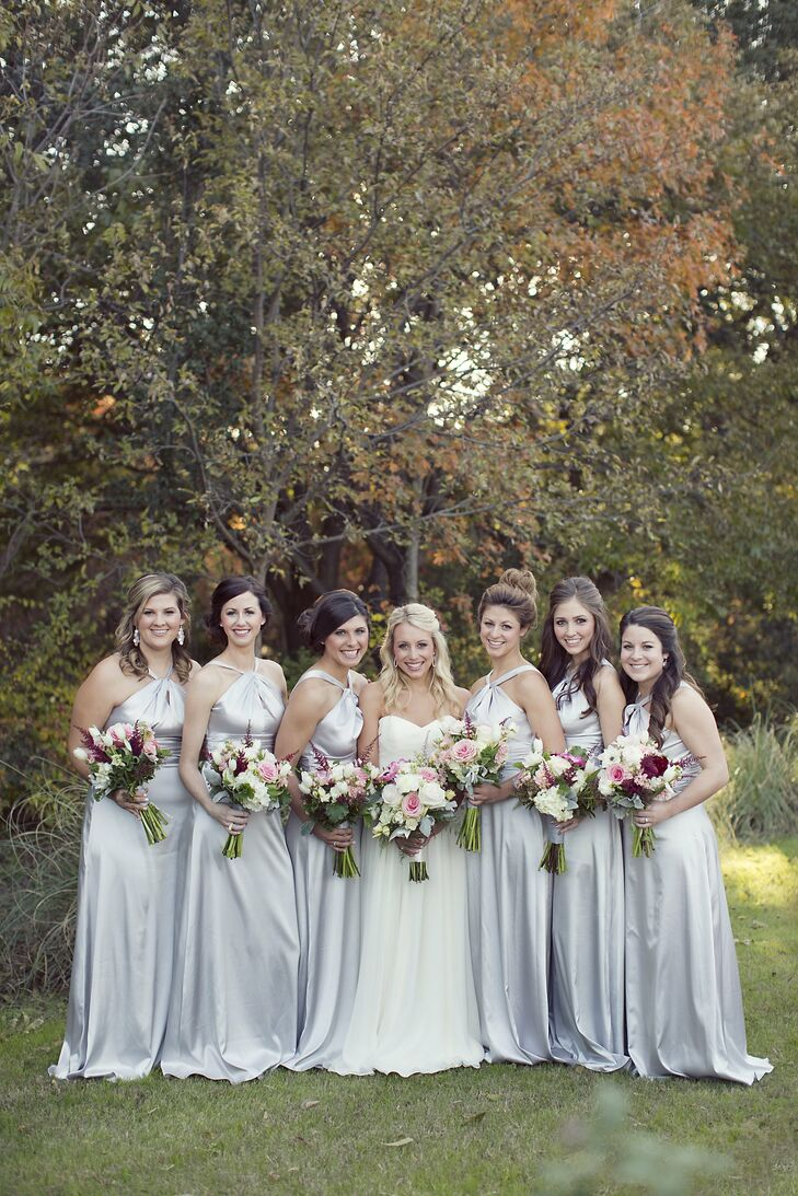 The bridesmaids wore matching silk silver gowns.