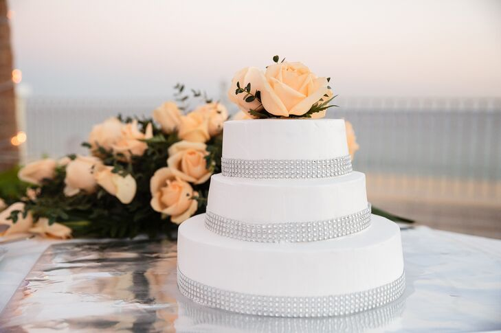 Tiny crystals wrapped around each tier of this three-tier cake added a gentle touch of sparkle to this modern design.