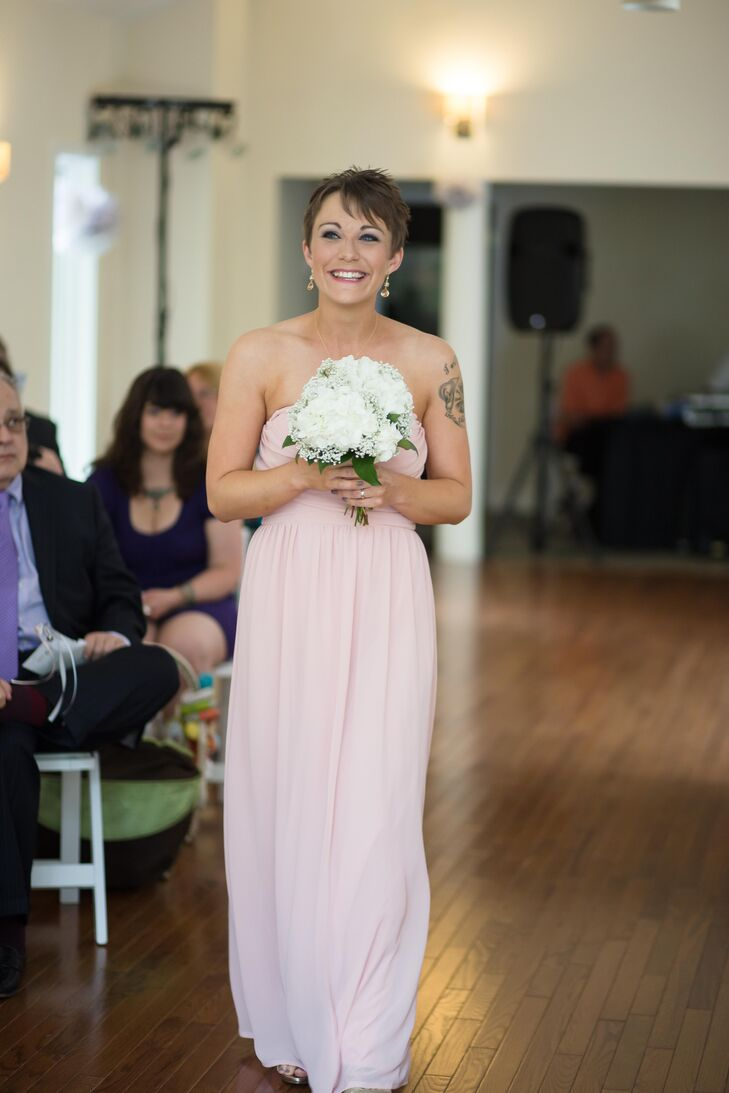 Mandy's maid of honor wore a strapless, blush dress from LuLus.com, while carrying a white hydrangea bouquet matching the other flower arrangements displayed throughout the wedding.