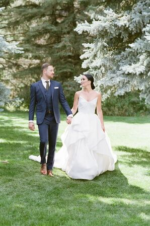 Elegant Couple with Blue Suit and Ball Gown Wedding Dress