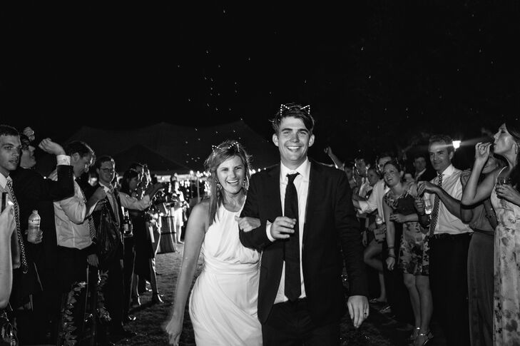 Before they left the reception, Caroline and Christopher made one last memory with friends and family members, complete with cat ears. Everyone blew bubbles as they made their way to the white Rolls-Royce exit car.
