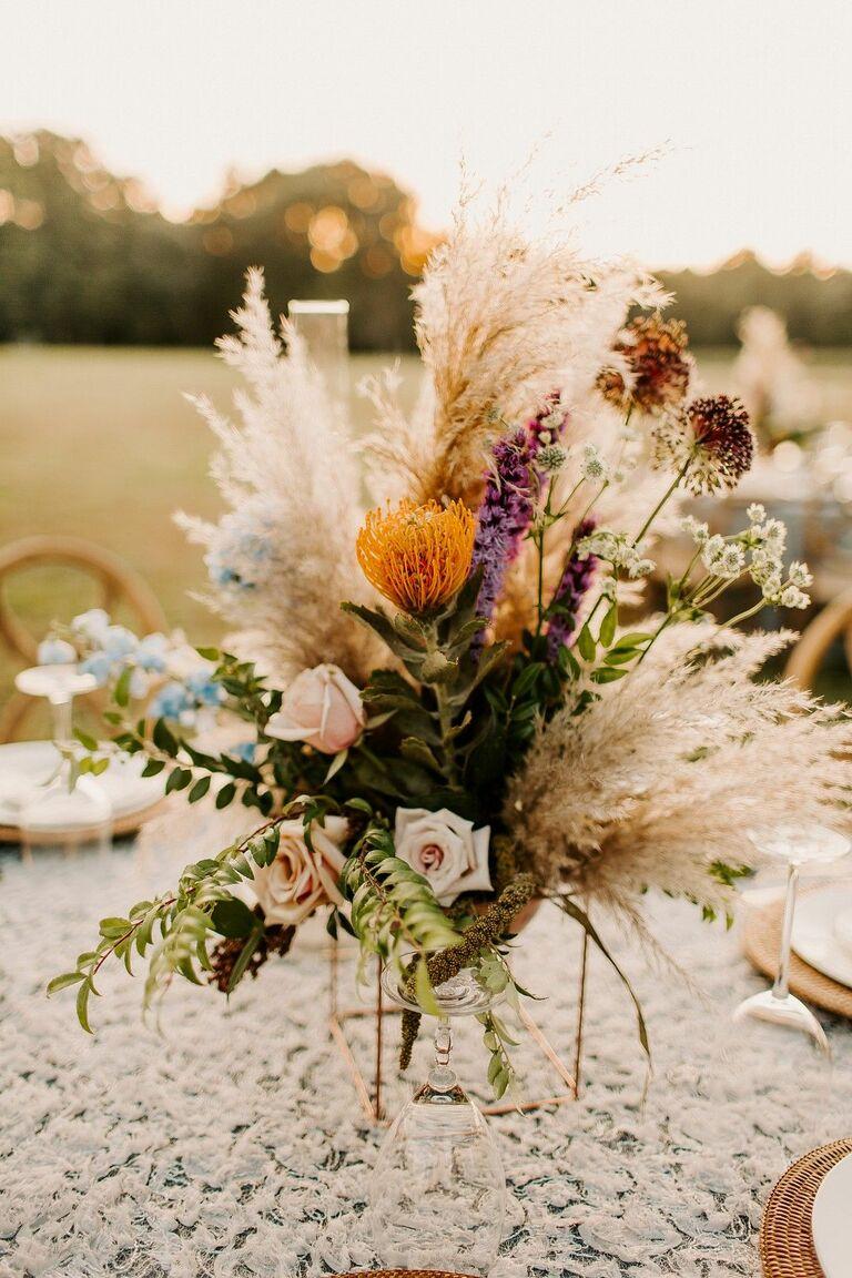 Arrangement with pincushion protea and pampas grass