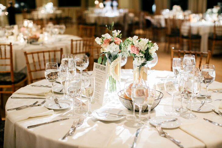 Centerpieces consisted of a variety of springy floral arrangements, included vases of pink roses and white freesias.