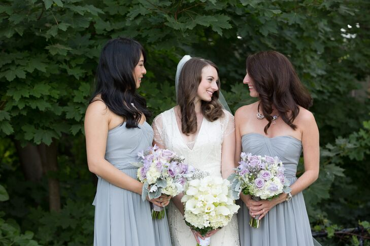 Playing off her own vintage-inspired Jenny Packham gown, Ashley had her two bridesmaids don floor-length, blue-gray chiffon dresses by Jenny Yoo, which exuded classic elegance. To tie into the wedding's subtle art deco theme, she gave each of the ladies glitzy Jenny Packham necklaces and bracelets to give the dresses a touch of wow.