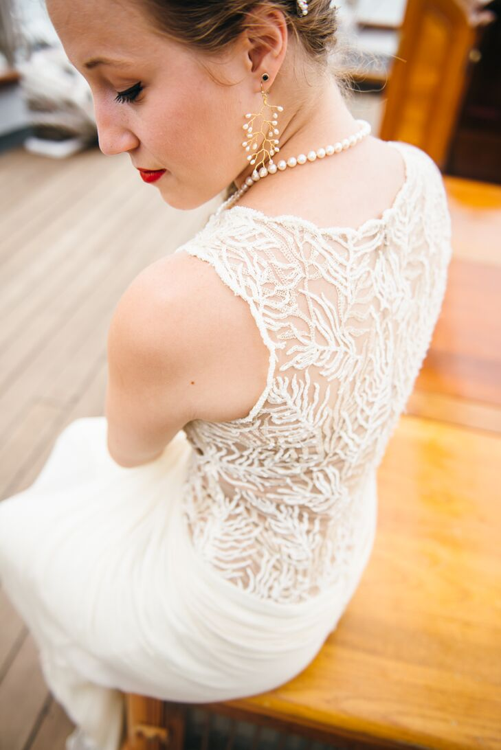 """Kate saw her BHLDN gown online and knew it was """"the one."""" """"The creamy off-white gave it a vintage look, and the beaded, embroidered vines were the most beautiful thing I had ever seen,"""" says Kate."""