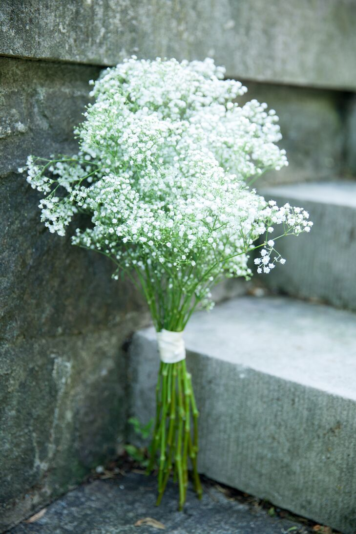 All the bridesmaids held bushels of baby's breath for their bouquets, tied around the stems by a white wrap. The simple flower arrangement went along with the simplicity of the day.