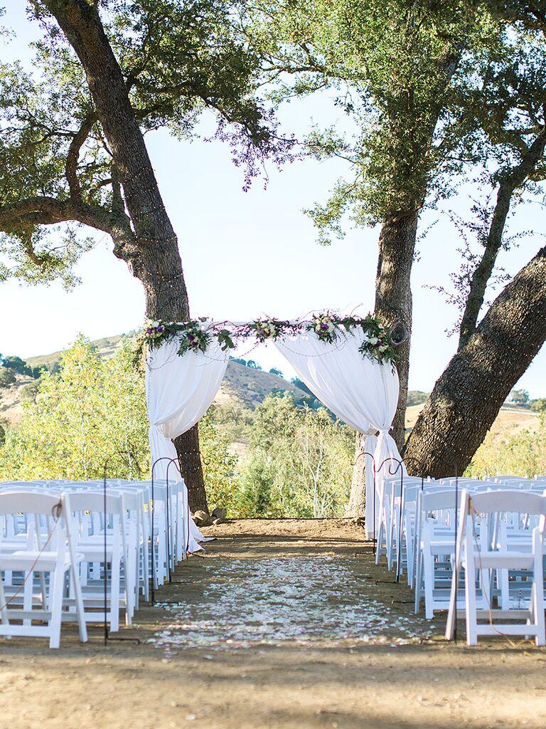 A white draped linen curtain arch