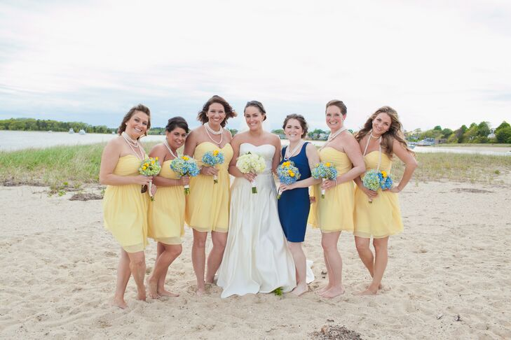 Jacquelyne's bridesmaids wore strapless yellow dresses with sweetheart necklines.