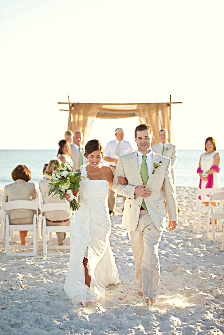 Ceremony and Reception Site: Watersound Beach CLub, Seaside, FL  Photography: Ryan Manthey and Lindsey Bray/pure 7 studios  Consultant: Jennifer Warwick-Lewis and Jennifer Fisher/It's a Shore THing Wedding and Event Planning Gown: Mori Lee, Rebecca's, Louisville, KY Bridesmaid Dresses: Abbingtons Bridal House, Owensboro, KY  Formalwear: JoS. A. Bank  Menu Cards: Sweet Bay Parties   Flowers and rentals: Celestine's Special Occasions   Cake: Yascha Becker/Sandestin Golf and Beach Resort Catering: Watersound Beach Club  Music: Ceremony: Carol Hayes; Reception: Brent LeMaster/Beachside DJ Honeymoon: Maui, HI  Registries: Pottery Barn