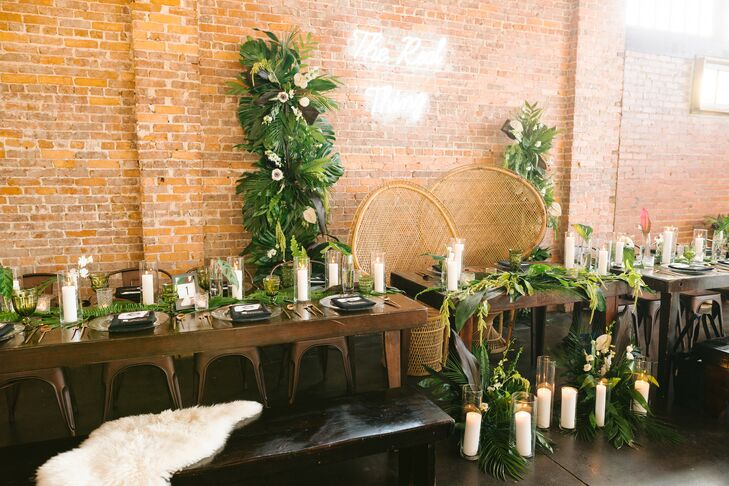 Modern Dining Tables with Tropical Plants, Candles and Wicker Sweetheart Chairs