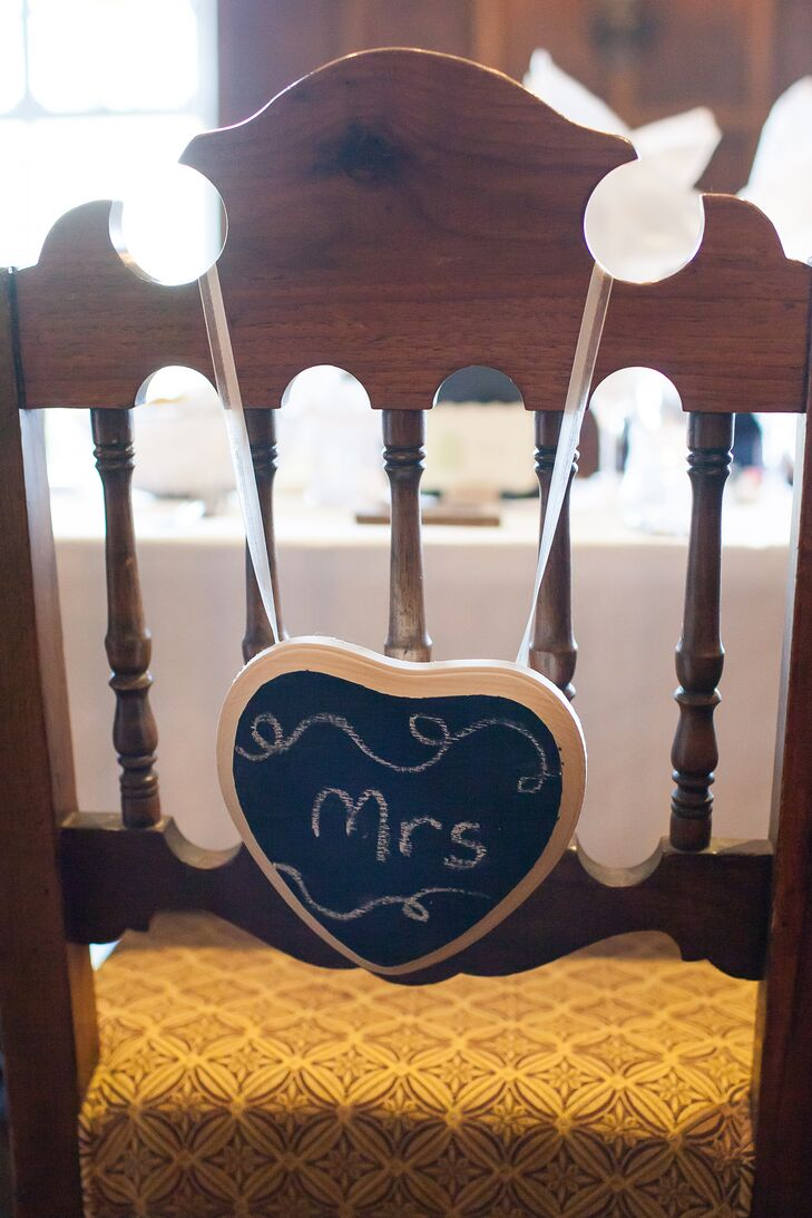 "Small chalkboard signs that said ""Mrs."" hung off the back of Nicole and Morgan's chairs at the reception."