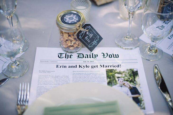 As favors, each guest received a mason jar filled with handmade caramel popcorn and a small tealight candle. Plus, since Kyle is a journalist, the pair created a wedding newspaper. They wrote about their relationship and about their wedding party.