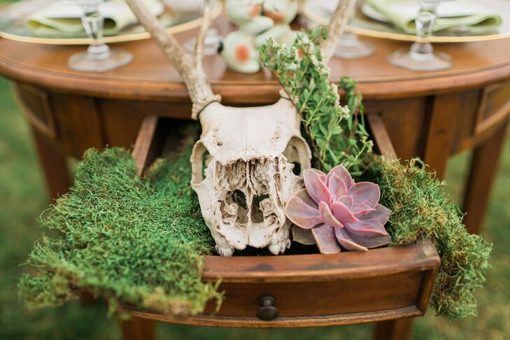 One of Jim's only requests during the planning process was that deer somehow be incorporated into the decor. Molly took this to heart and integrated antlers into the centerpieces and tablescapes, even using a deer skull, which Jim found in the woods, as the focal piece for their