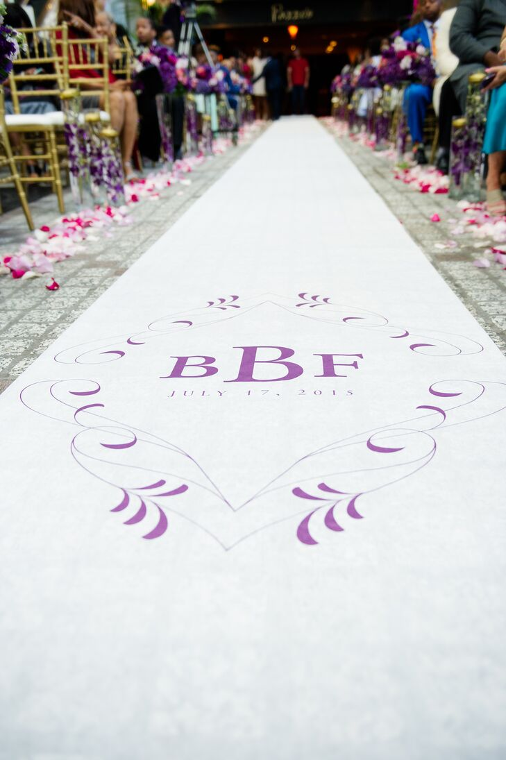 The aisle was lined with pink and white rose petals and featured a custom monogrammed runner.