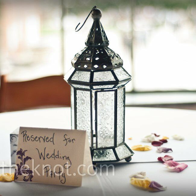 Joy purchased 10 lanterns that sporadically dotted the tables. They were similar to the ones lining the aisles at the ceremony; a tiny detail that Joy carried throughout.