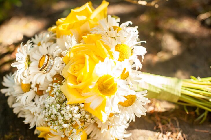 "The bridal bouquet was a mix of yellow roses and ditch daisies, accented with baby's breath. ""My favorite flowers have always been ditch daisies, the ones that grow along the freeway,"" says Jessica. ""Those were my flowers and the color scheme for the wedding. I added accents of blue for the ""something blue"" tradition of old days."""