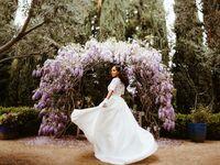 bride in front of purple ceremony altar elopement
