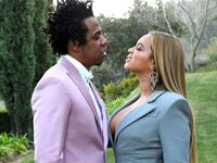 Beyonce and Jay Z attend ROC Nation brunch in January 2020 in LA look at each other in a meadow