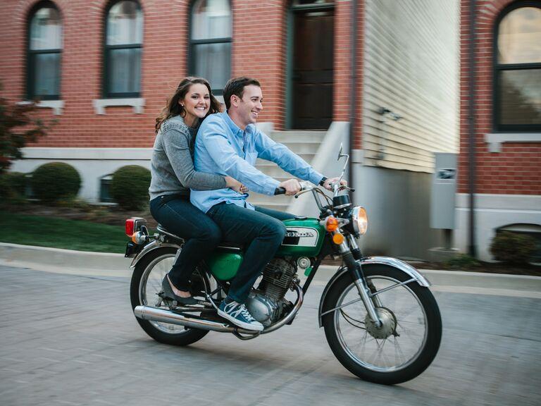 Newly engaged couple on Honda mini bike