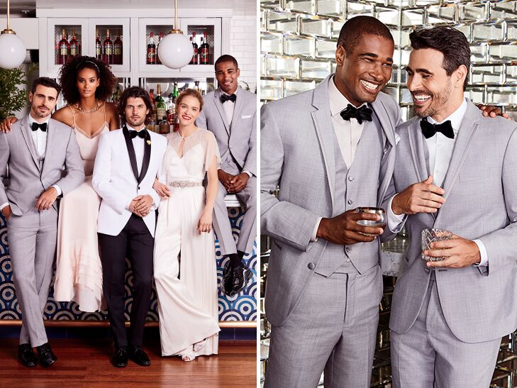 bride and groom with formal bridal party in gray