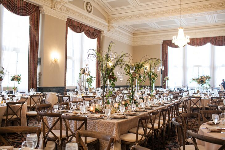 The couple wanted to decorate the room in subtle neutrals and light accents of color. They used a soft palette of gray and gold with hints of navy and peach.   They wanted the flowers to be simple decorated the table with bouquets of ivory and peach with magnolia leaves.