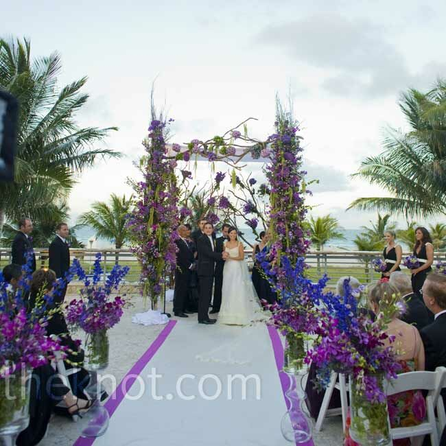 The bride's favorite color was in full force at the ceremony, showing up in the aisle runner, the flowers lining the aisle, and the elaborate huppah.