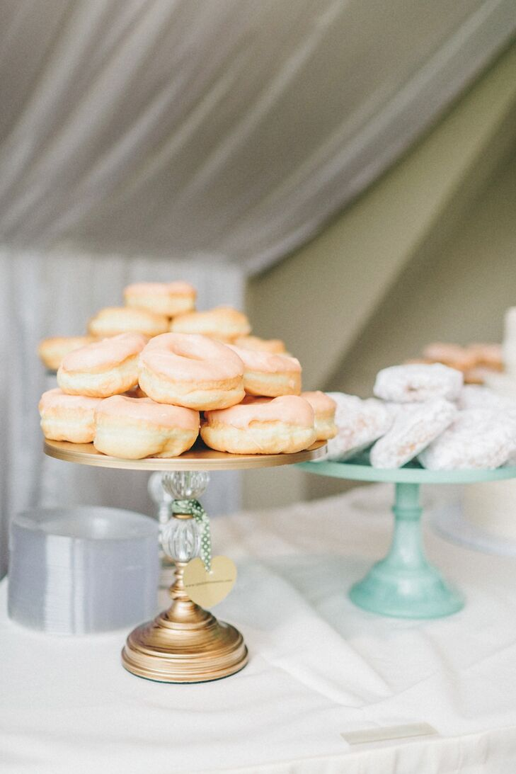 In addition to a delicious cake, stacks of doughnuts were offered to guests as an additional sweet treat.