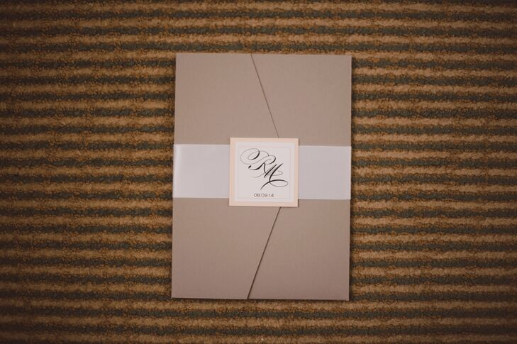 The invitations were enclosed in a muted, slate gray pocketfold and wrapped with a white silk ribbon and the couple's monogram.