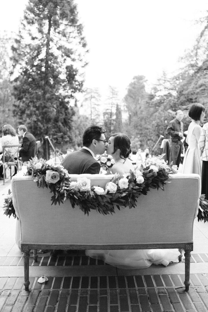 During dinner at Montalvo Arts Center in Saratoga, California, Jauchy and Jeffrey sat on a love seat draped with a lush floral garland.