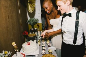 Emily and Ericka Cutting Wedding Cake