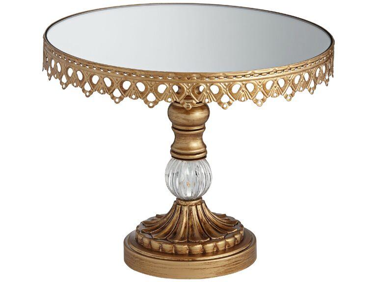Elaborate gold wedding cake pedestal with mirrored cake plate