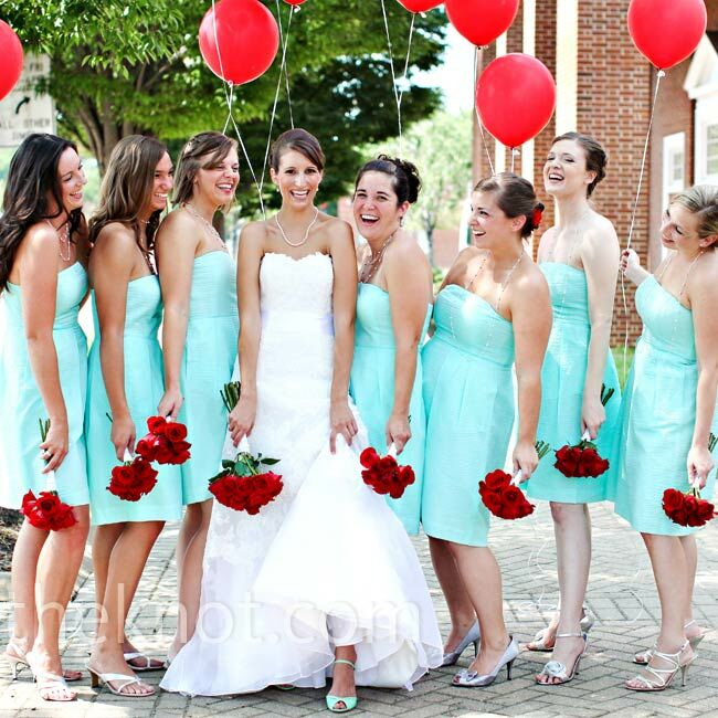 Holly's bridesmaids wore summery J. Crew dresses in her signature blue color, matching the bride's Tiffany blue shoes.
