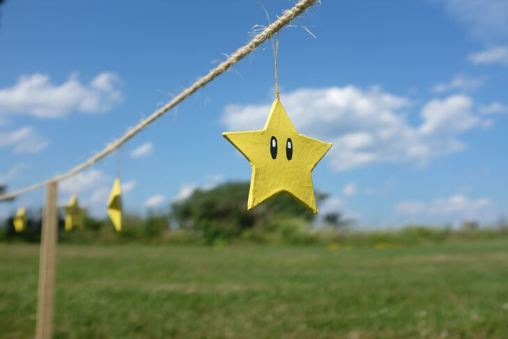 Handmade super stars were string along a piece of twine for the outdoor wedding decor.