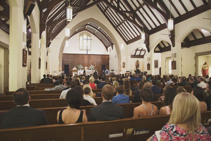 The couple had a traditional Catholic ceremony at St. Agnes Catholic Church. They loved the vaulted wood-decorated ceilings.