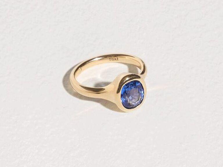 Gold bezel-set sapphire engagement ring