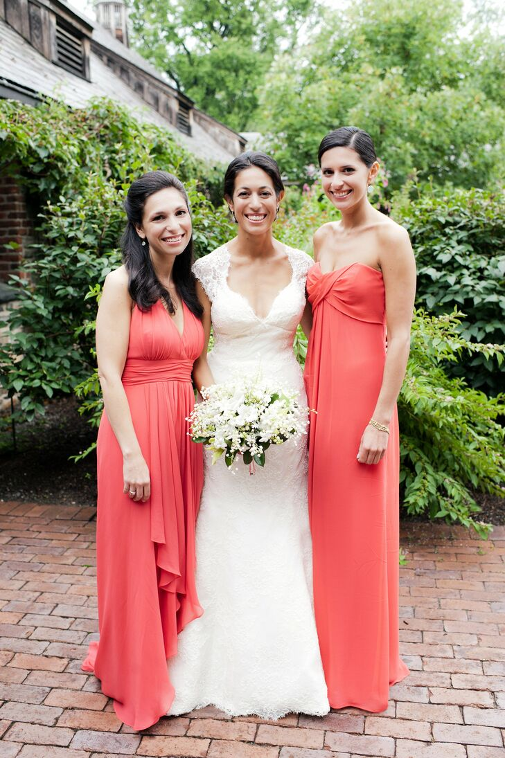 The maids of honor wore coral dresses in different silhouettes.