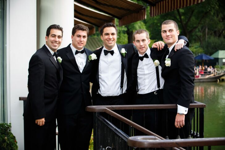 Eddie and his groomsmen wore classic black tuxedos with white shirts and black bow ties from Mark Thiesfeld Clothier.