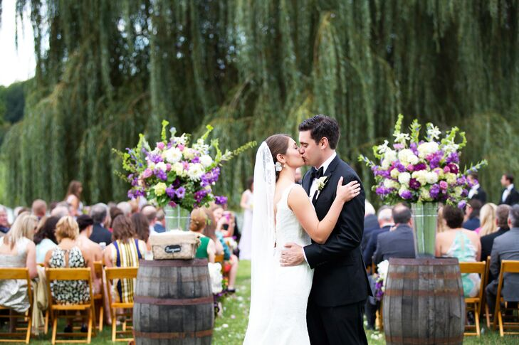 A picture-perfect ceremony took place under a willow tree, overlooking the pond and vineyards at Trump Winery.