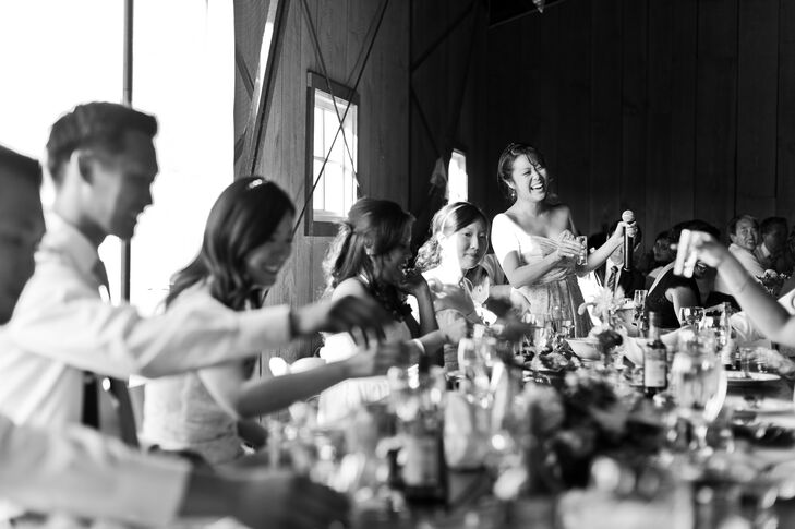 """In keeping with the intimate feel of the reception, Jo and Tom shared a table with their bridal party and their spouses. """"We wanted to open up the night with a toast, so we had to take a massive group shot of soju—a Korean rice liquor—in honor of our favorite drink,"""" Jo says."""