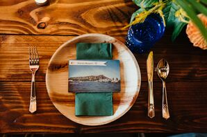Place Setting with Postcard, Wood Chargers and Gold Flatware