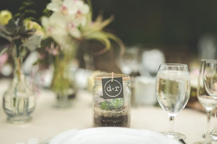 """""""To thank our guests for joining us on such a special day, Derik and I continued the nature inspired theme and made succulent terrariums to take home as a reminder of our wedding at the Conservatory,"""" says Rebecca."""