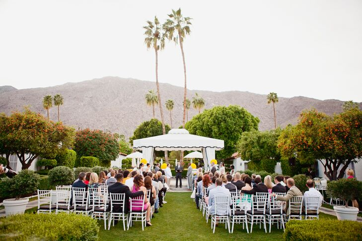 Philip and Ryan were married at the white canopy during the outdoor ceremony that took place at Avalon Hotel Palm Springs in Palm Springs, California. Guests were seated in white chiavari chairs with black cushions to watch the marriage take place.