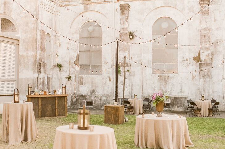 The reception was also held at Marigny Opera House, beginning with an outdoor cocktail hour at dusk with festoon lighting creating a festive atmosphere.