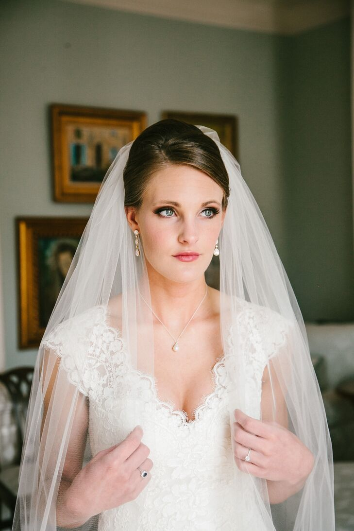 Bride In A Cathedral Veil And Drop Pearl Jewelry
