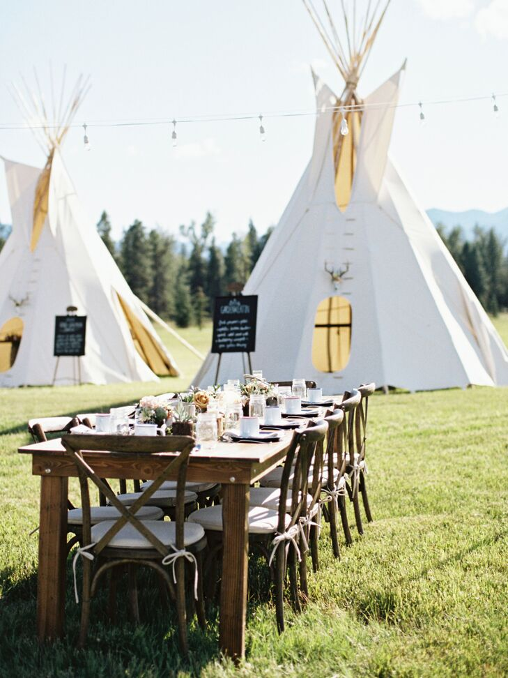 The reception was held at the same location, near the lake, with farm tables under a canopy of string lights among four glowing tepee-inspired tents.