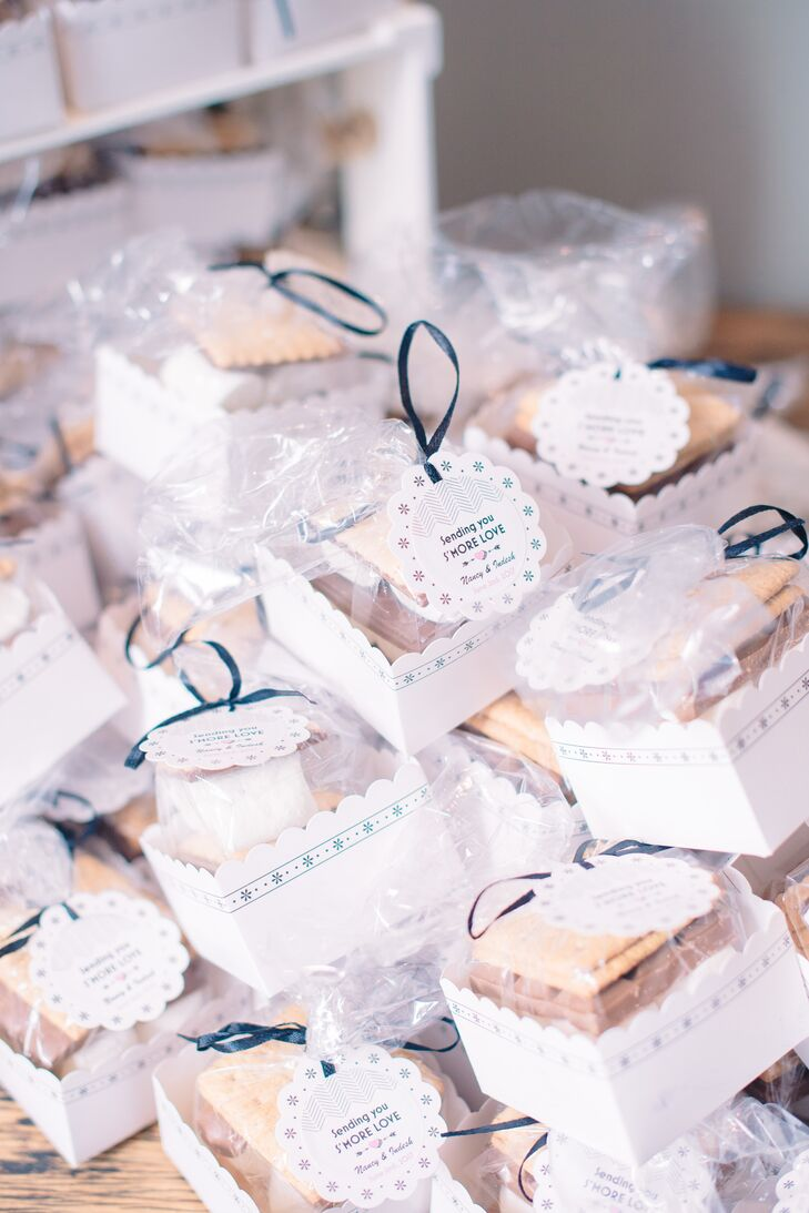 At the end of the evening, Nancy and Indesh sent their guests home with s'mores kits to enjoy as a late-night snack. The sweet treats captured the laid-back vibe of Le Belvedere's woodland setting and were decorated with personalized gift tags with the couple's names and wedding date.