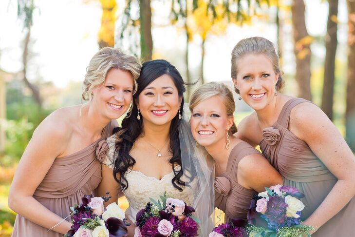 Each of the three bridesmaids wore one-shoulder, taupe dresses by Bill Levkoff.